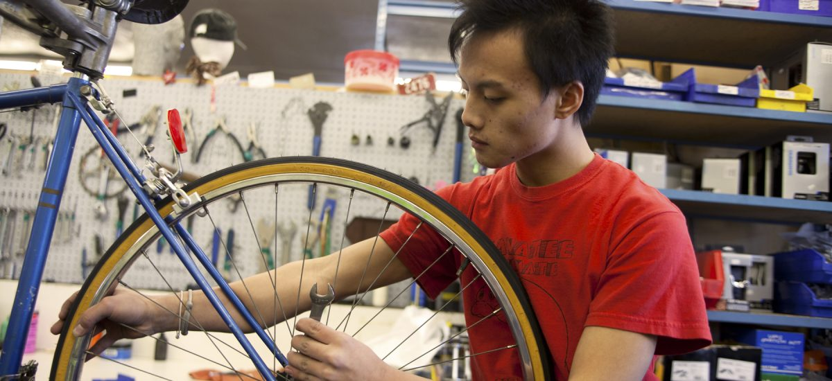 Youth working in Express Bike Shop