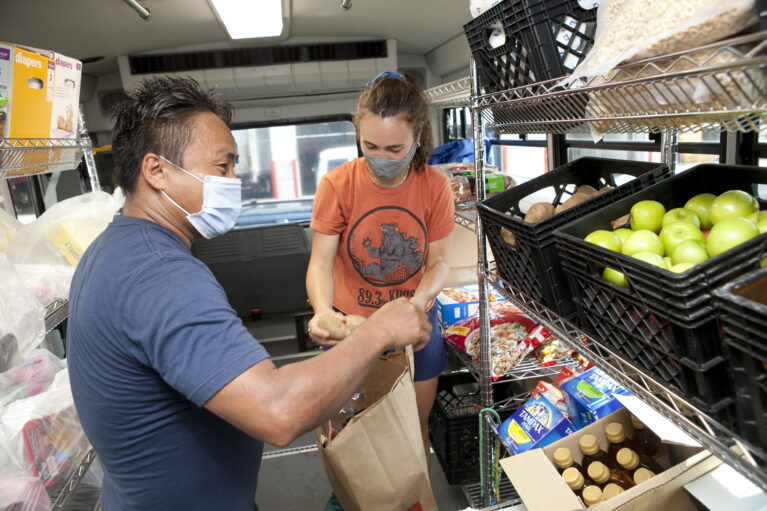 Keystone staff give food at a Foodmobile distribution