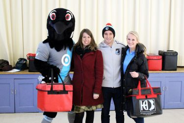 MN United player and mascot delivering Meals on Wheels
