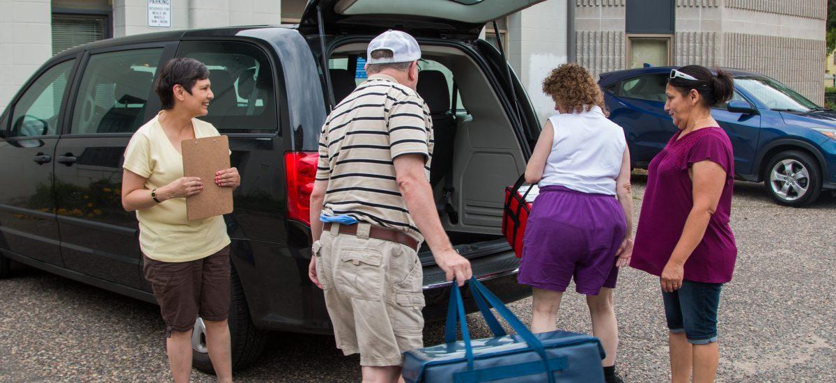 Meals on Wheels volunteers packing van