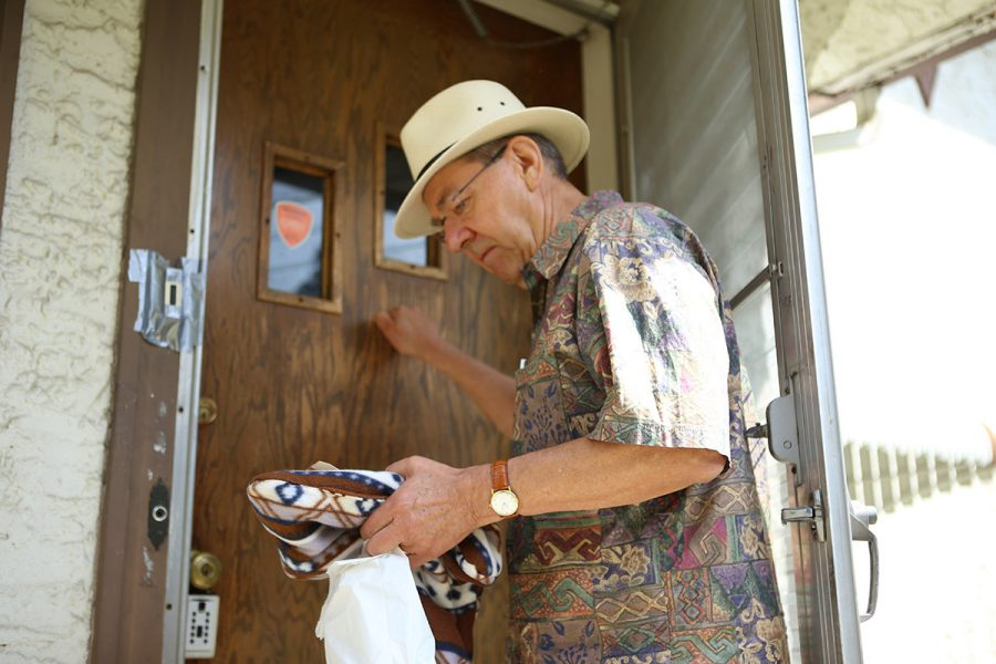 Man delivering Meals on Wheels dinner to home
