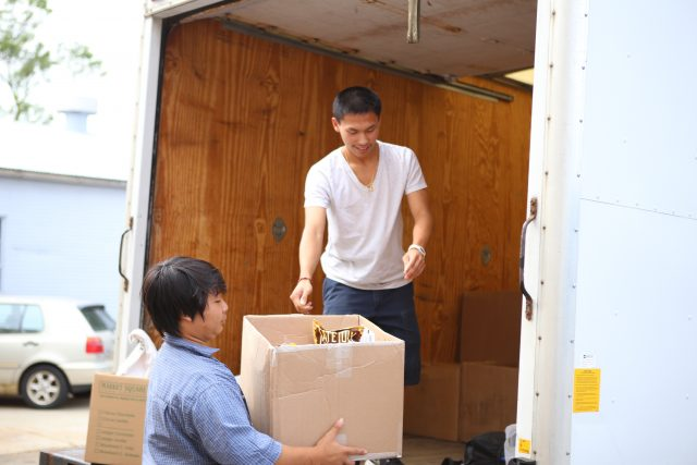 Two volunteers loading truck